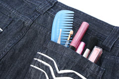 Cosmetics in jeans pocket Stock Image