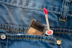 Cosmetics in jeans pocket Stock Images