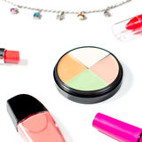 Cosmetics and jewelry on white background Stock Image
