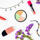 Cosmetics and jewelry on white background with flowers Stock Photos