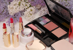 Cosmetics and lilac blossom Royalty Free Stock Images