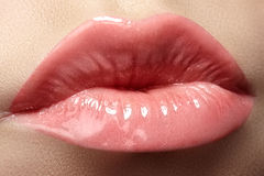 Cosmetics & lips. Macro of fashion lipgloss makeup in sweet kiss Royalty Free Stock Photography