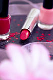 Cosmetics: lipsticks and nail polish Royalty Free Stock Photos