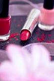Cosmetics: lipsticks and nail polish Royalty Free Stock Photos