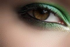 Cosmetics, macro eye make-up. Fashion mint shadows royalty free stock photos
