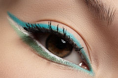 Cosmetics, macro eye make-up. Fashion mint shadows Stock Photo