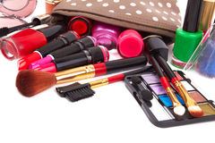 Cosmetics. Make up bag with cosmetics and brushes isolated on white Stock Photo