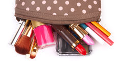 Cosmetics. Make up bag with cosmetics and brushes isolated on white Stock Photos