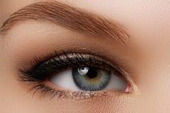 Cosmetics & make-up. Beautiful female eye with black liner stock photos