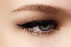 Cosmetics & make-up. Beautiful female eye with black liner Royalty Free Stock Photo