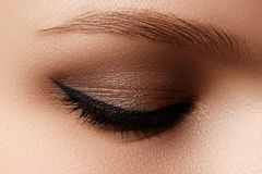 Cosmetics & make-up. Beautiful female eye with sexy black liner Stock Images