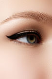 Cosmetics & make-up. Beautiful female eye with sexy black liner Royalty Free Stock Image