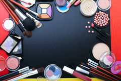 Cosmetics make-up on black background. Top view mock up. Stock Photography