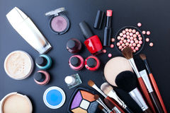 Cosmetics make-up on black background. Top view mock up. Stock Images