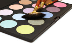 Cosmetics and make-up - eyeshadow and brush Royalty Free Stock Photo