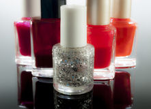 Cosmetics. Make up and nailpolish on black reflex background royalty free stock photo