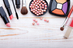 Cosmetics make-up on white wooden. background. Top Royalty Free Stock Images