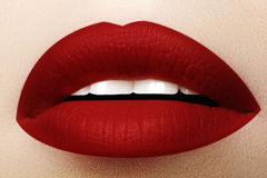 Cosmetics, makeup. Bright lipstick on lips. Closeup of beautiful female mouth with red lip makeup. Part of face. Cosmetics, makeup and trends. Bright lip gloss Stock Image