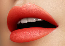 Cosmetics, makeup. Bright lipstick on lips. Closeup of beautiful female mouth with red and pink lip makeup. Part of face. Cosmetics, makeup and trends. Bright Royalty Free Stock Photos