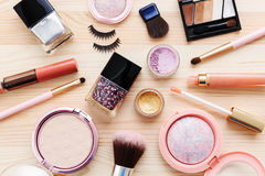 Cosmetics and makeup products. On wooden background Royalty Free Stock Photography