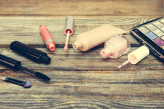 Cosmetics: mascara, concealer, nail polish, perfume, lip gloss and eye shadow Stock Images