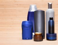 Cosmetics for men. Mens cosmetics. Various cosmetic products for men on a wooden surface. Copy space stock images