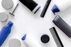 Cosmetics for men`s hair on white background top view copyspace Stock Photos