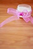 Cosmetics moisturizing lotion with pink ribbon Stock Photo