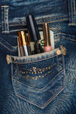 Cosmetics and money sticks out of the pocket of his jeans with r Royalty Free Stock Image