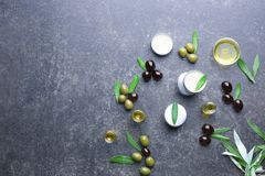 Cosmetics with olive oil extract. On grunge table royalty free stock photos