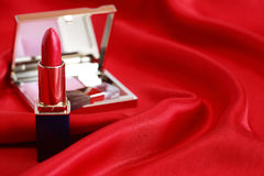 Cosmetics On Red Silk Stock Images