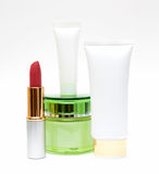 Cosmetics Packaging isolated on white background. Cosmetics packs and containers: tubes, boxes, sprayers,lipstick,Sunscreen Stock Image