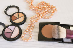 Cosmetics and pearls background Royalty Free Stock Images