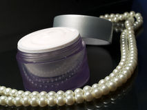 Cosmetics and pearls Royalty Free Stock Images