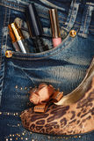 Cosmetics and perfumery sticks out of the pocket of his jeans Royalty Free Stock Photography