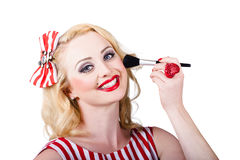 Cosmetics pin-up model applying blusher makeup Stock Photos