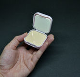 Cosmetics Powder Compact in hand Royalty Free Stock Images