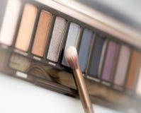 Cosmetics powders with brush Royalty Free Stock Photo