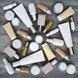Cosmetics products located on the wooden background. Royalty Free Stock Image