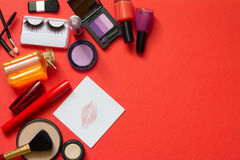Cosmetics and red lipstick on the paper abstract background Stock Images