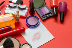 Cosmetics and red lipstick on the paper abstract background Royalty Free Stock Image