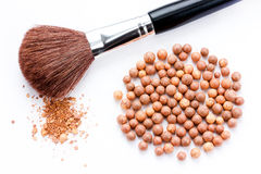 Cosmetics rouge balls with a brush isolated Stock Images