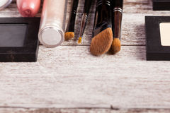 Cosmetics on rustic wood Royalty Free Stock Images