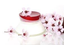 Cosmetics and Sakura flower Stock Photos