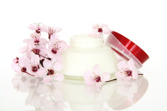 Cosmetics and Sakura flower Royalty Free Stock Photo