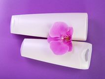 Cosmetics set for bathing, with an orchid flower Royalty Free Stock Photography