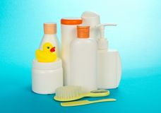 Cosmetics set for kids, hairbrush and crest Royalty Free Stock Images