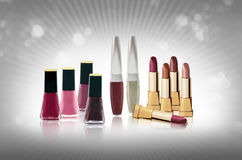 Cosmetics set - lipsticks and nail polishes Royalty Free Stock Images