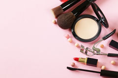 Cosmetics set for make-up. (face powder, lipstick, mascara brush Stock Photography