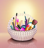 Cosmetics set into a pearl basket Royalty Free Stock Photography